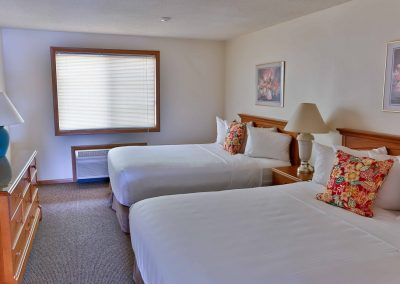 Guest room with two queen beds.