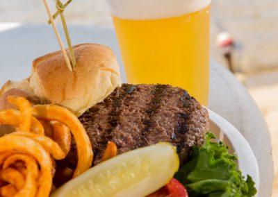 Hamburger, onion rings, and a beer.