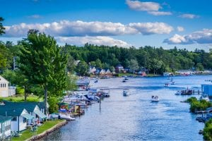 A collection of boats hangs out in Paugus Bay, one of the many things to do in Laconia, NH, in the summer.